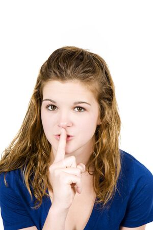 Young girl with her finger to her lips Stock Photo - 5047302