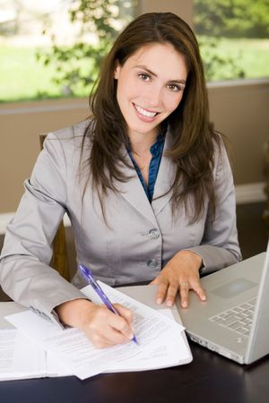 entrepeneur: Friendly young business woman at her desk