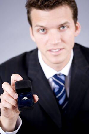 Man on his knees proposing photo