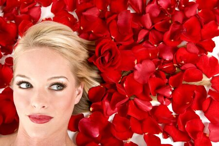woman laying: Beautiful woman laying in a bed of roses