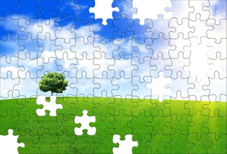 Spring landscape with a lone tree on a hill and puzzle pattern photo