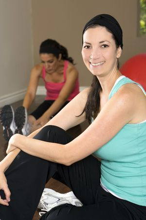 Young woman exercising at a gym photo