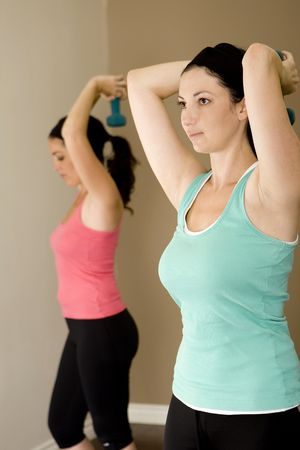Young woman exercising at a gym Stock Photo - 5130090