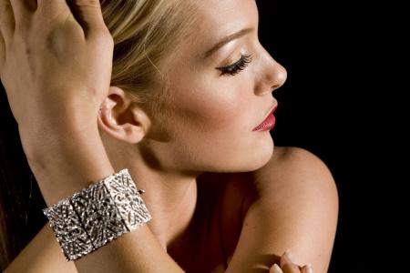 Gorgeous woman wearing a diamond bracelet photo
