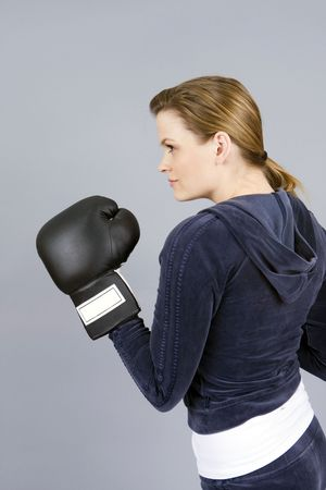 young woman exercising with boxing gloves photo