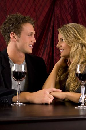 Attractive young couple drinking wine Stock Photo - 5130132