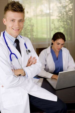 Friendly young medical professionals working in an office photo