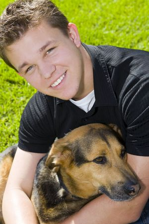 Young man and his dog - man's best friend