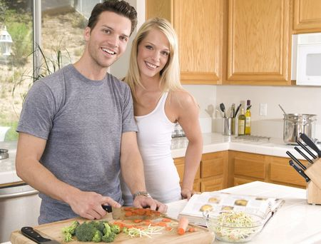 Attractive young couple in the kitchen photo
