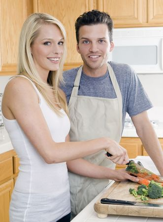 Attractive young couple in the kitchen Stock Photo - 5154388