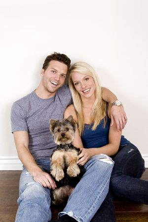 Attractive young couple sitting in their new home photo
