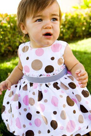 Cute little girl in the grass