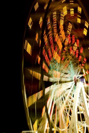 Ferris wheel at night with a motion blur Stock Photo - 5164672