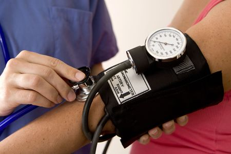 cuffs: Doctor or nurse taking a patients blood pressure Stock Photo