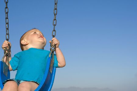chain swing ride: Toodler at the beach on a swing