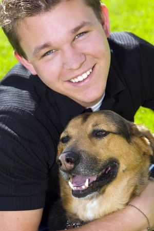 Young man and his dog - mans best friend photo