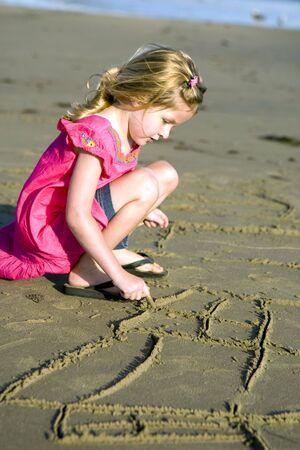 Beautiful little girl at the beach photo