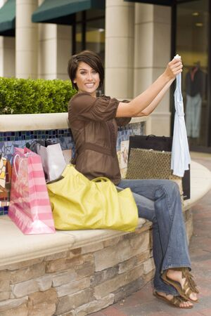 Young woman shopping at an outdoor mall photo