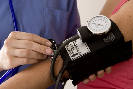 or nurse taking a patient's blood pressure