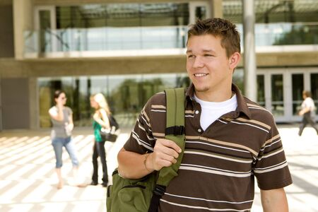 Young man at school holding a book bag Stock Photo - 5305466