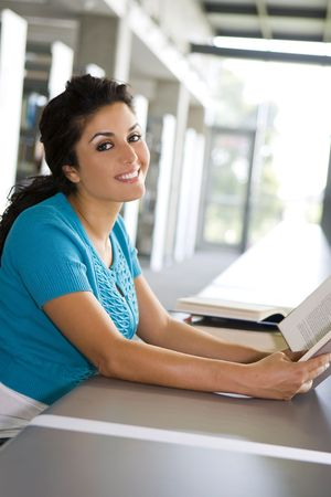 Young woman reading a book at school photo