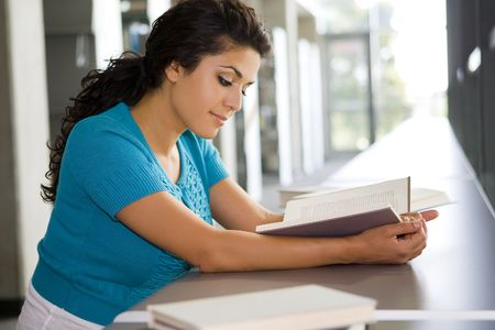 Young woman reading a book at school Stock Photo