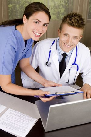 Friendly young medical professionals working in an office Stock Photo - 5305489