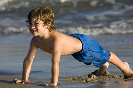 swimming shorts: Little boy at the beach