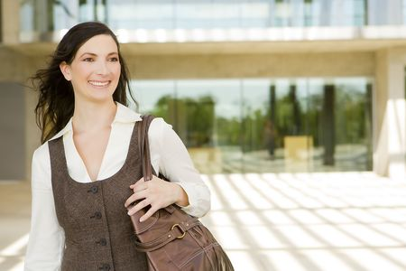 Happy young business woman outside Stock Photo - 5335860