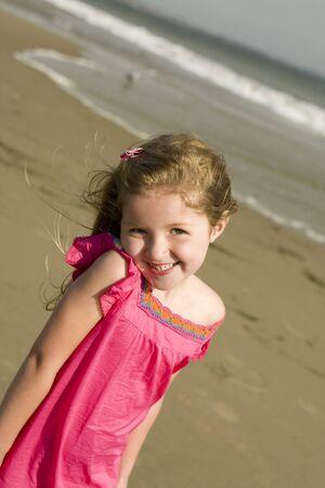 Mooi meisje op het strand  Stockfoto