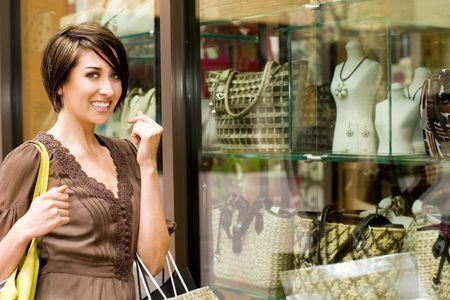 Young woman shopping at an outdoor mall Stock Photo