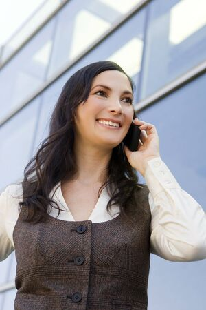 Happy young business woman on her phone Stock Photo - 5413195