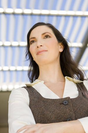 Happy young business woman outside Stock Photo - 5413211