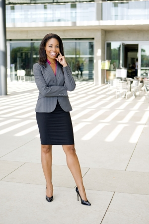 Attractive young business professionl outside her office Stock Photo - 5454990