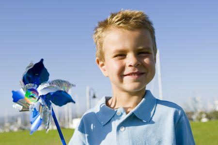 Little boy blowing on a pinwheel