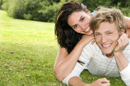 Happy young couple at a park Stock Photo