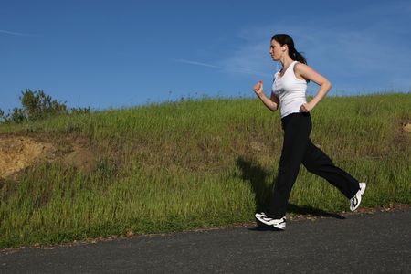 Woman running on a sunny day Stock Photo - 5454955