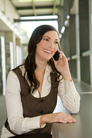 Happy young business woman on her phone Stock Photo - 5454970