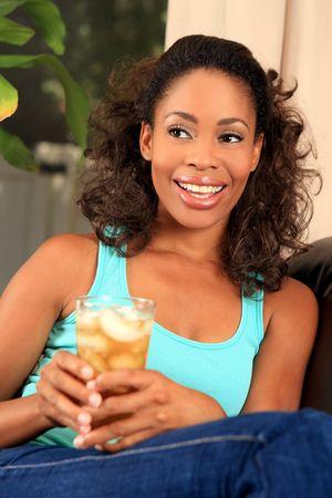 Pretty woman drinking iced tea