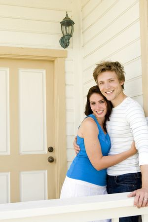 Loving couple outside of their home Stock Photo
