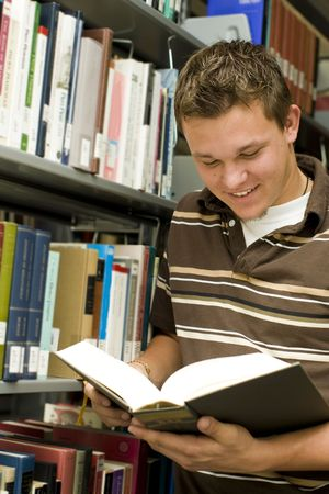 Man looking at books in a library Stock Photo - 5481543