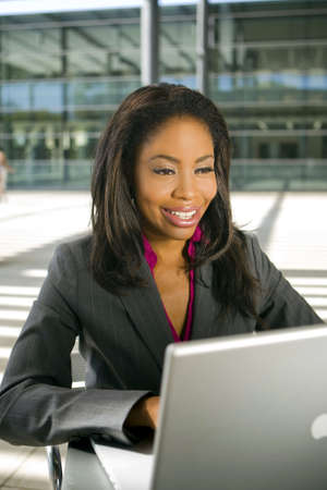 Young business woman working on her laptop photo
