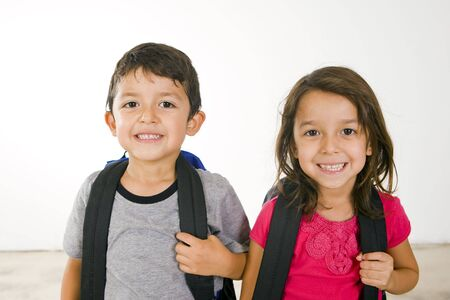 book bags: Little boy and girl with their book bags