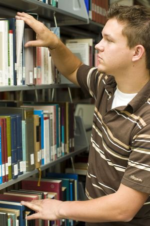 Man looking at books in a library Stock Photo - 5534489