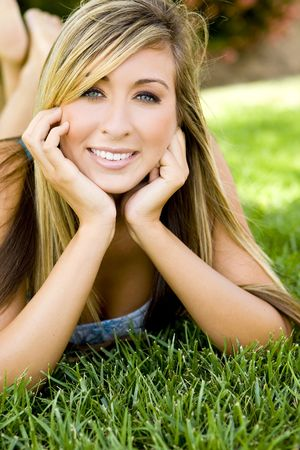 Young attractive woman sitting outside photo