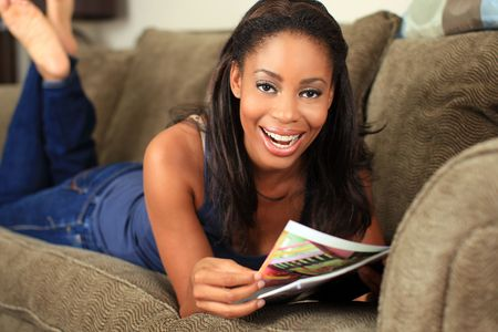Woman reading a magazine on the couch