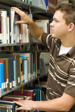 Man looking at books in a library Stock Photo - 5583405