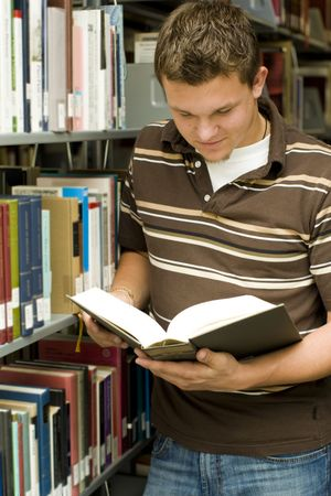 Man looking at books in a library Stock Photo - 5583467