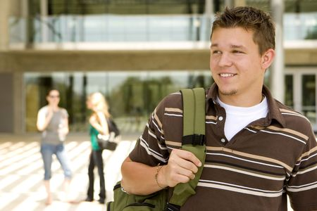 Young man at school holding a book bag Stock Photo - 5583390