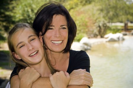 parent and teenager: Mother and daughter outdoors on a Spring day Stock Photo
